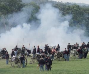 Reenactors fire artillery at Gettysburg